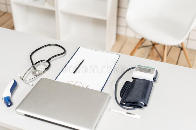 Medical equipment and Laptop computer on Doctor workspace. Medical equipment and Laptop computer on Doctor workspace stock photo