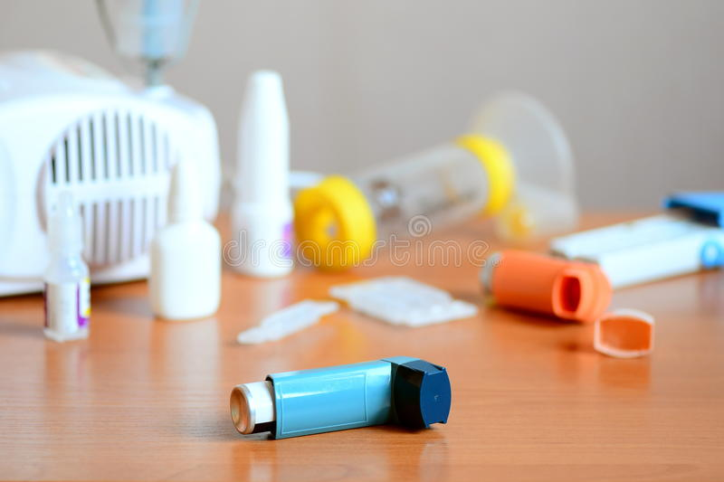 Medical equipment and medicines for treatment of asthma. Nebulizer, inhaler, peak flow meter, spacer, nebula stock photos