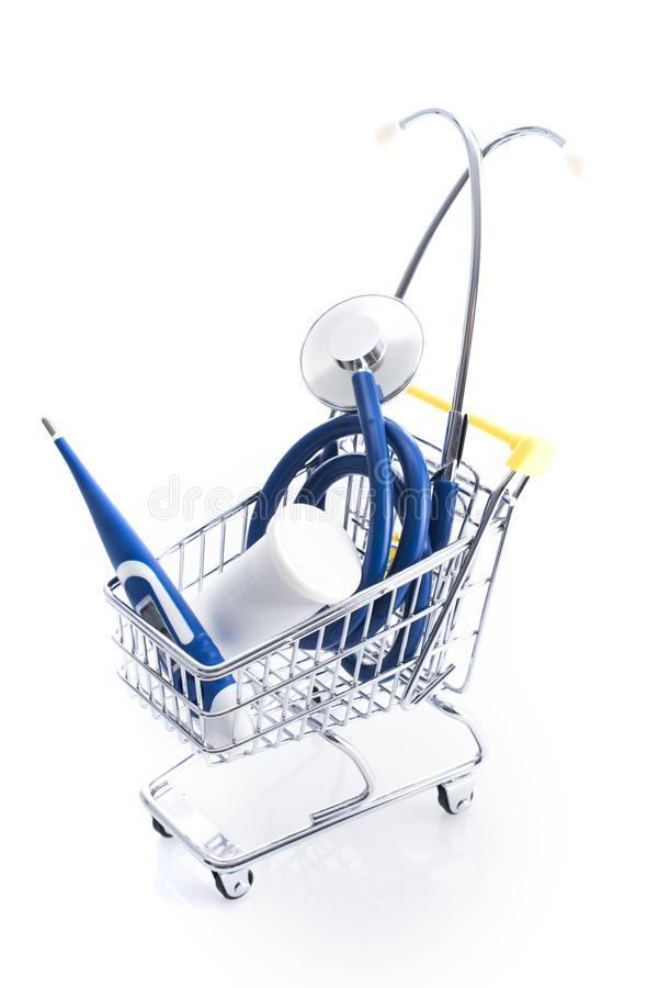 Medical equipment supplies in a shopping cart. Medical accessories shop and home healthcare items concept stock photo