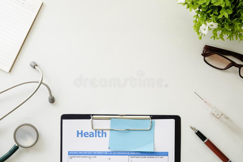 Medical equipment,White background with stethoscope office mockup. Medical equipment,White background with stethoscope, clipboard, pen, medical syringe and royalty free stock image