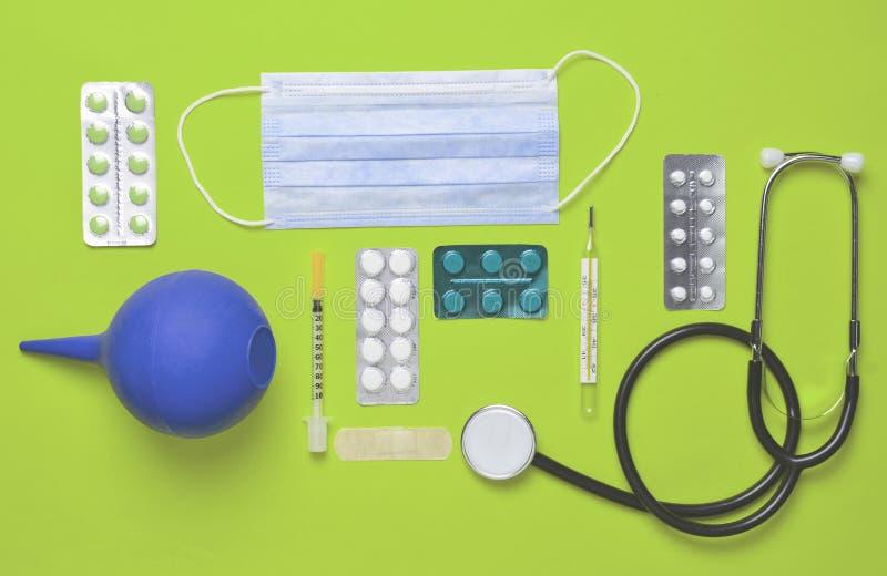 Medical equipment on a yellow background. Enema, blisters pills, notepad, stethoscope, syringe, thermometer, manometer. Medical c. Medical equipment on a yellow stock image