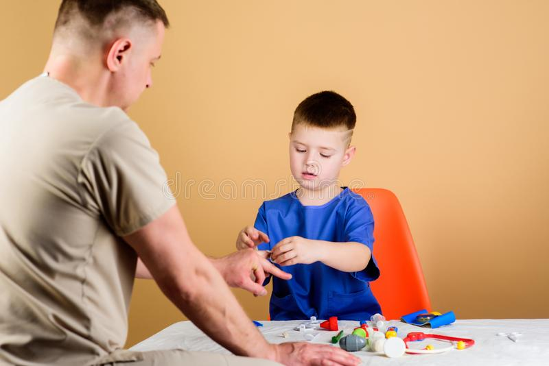 Medical examination. Hospital worker. Medical service. Analysis laboratory. Kid little doctor sit table medical tools stock photos
