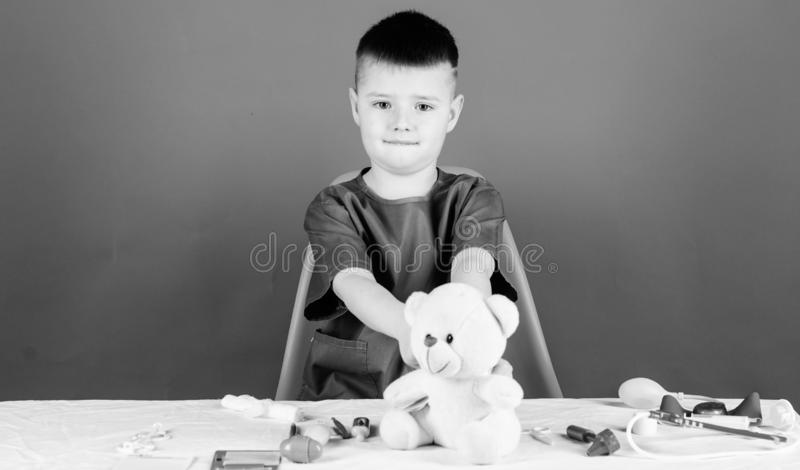 Medical examination. Medical procedures for teddy bear. Boy cute child future doctor career. Hospital worker. Health. Care. Medicine concept. Kid little doctor royalty free stock photo