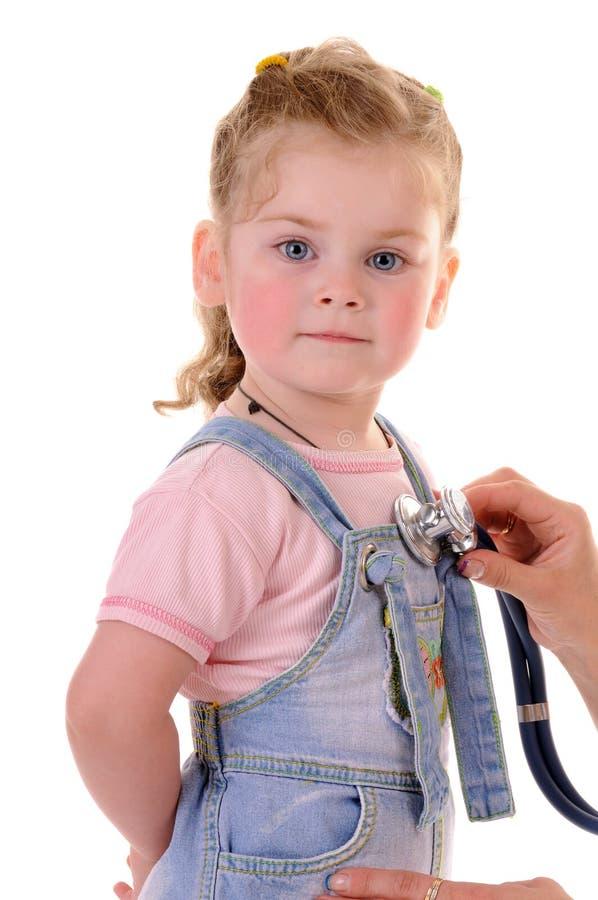 Medical examing of small girl stock photography