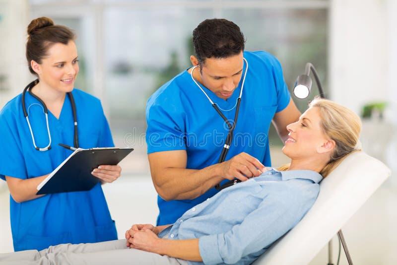Medical examining senior patient. Medical doctor examining senior patient in office royalty free stock photos