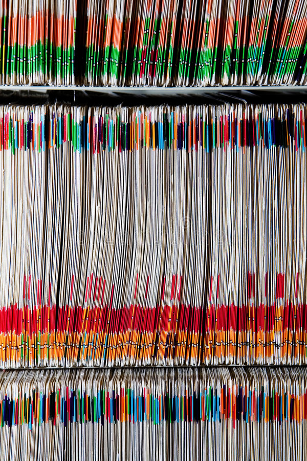 Medical Files. Medical records in filing cabinet color coded for quicker sorting and access