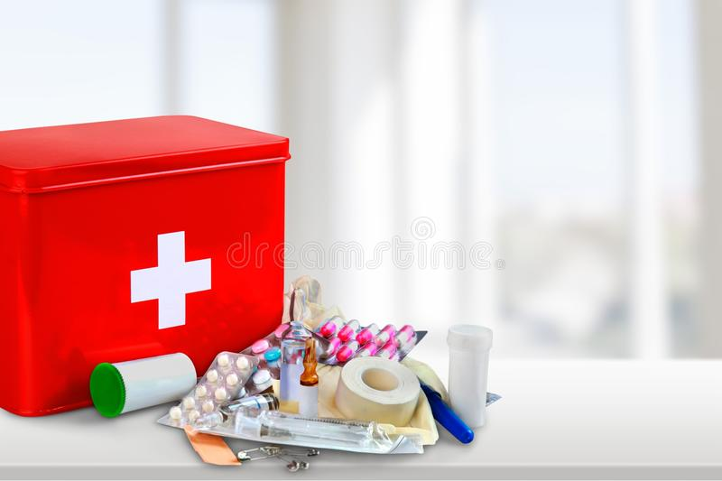 First aid kit with medical supplies on light. Medical first aid first aid kit medical supplies white background healthcare and medicine still life royalty free stock photography