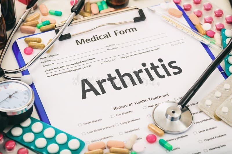Medical form, diagnosis arthritis. Medical form on a table, diagnosis arthritis royalty free stock photography