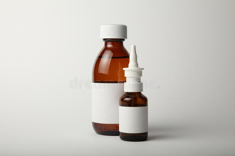 Medical glass bottle and spray mockup. Empty white label stock photography