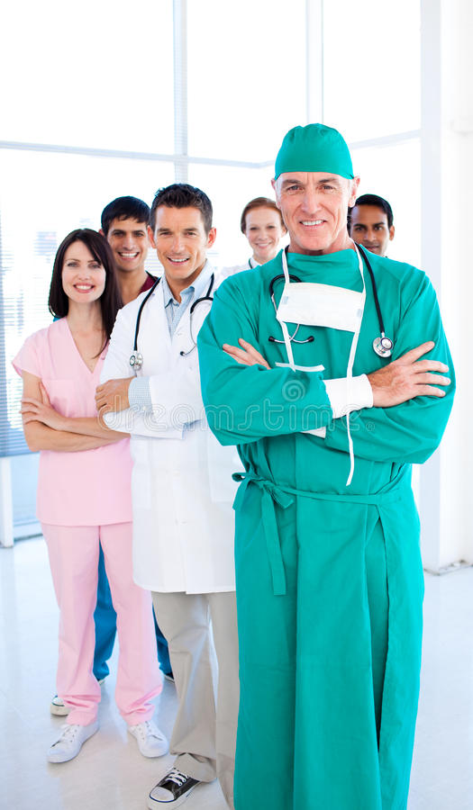 Medical group standing in front of the camera stock image