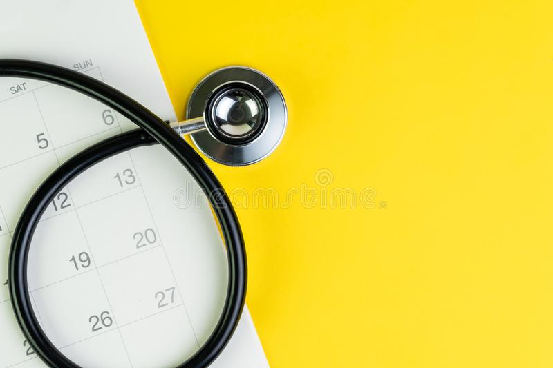 Medical and health care calendar, reminder, schedule or appointment concept, doctor`s stethoscope on white clean calendar with royalty free stock images