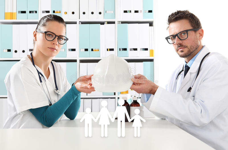 Medical health insurance concept, doctors hands with family icon royalty free stock photos