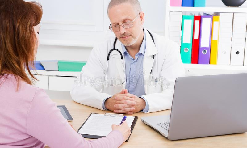 Medical and healthcare concept. Bright portrait of doctor with patient royalty free stock photo