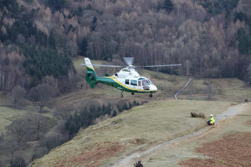 Lake District England Travel Destinations. A medical helicopter taking off from Cat Bells near Keswick in the English Lake District after dropping off a doctor stock images