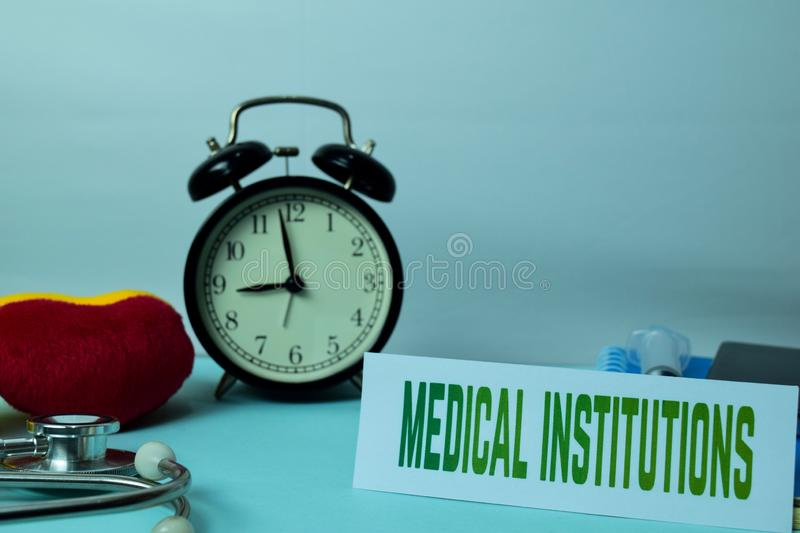 Medical Institutions Planning on Background of Working Table with Office Supplies. Medical and Healthcare Concept Planning on White Background stock photography