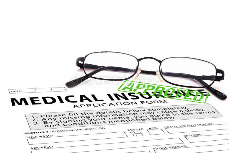 Medical insurance application form with green approved stamp stock image
