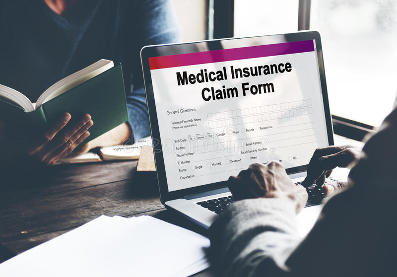 Medical Insurance Claim Form Document Concept. People Checking Medical Insurance Claim Form Document royalty free stock photography