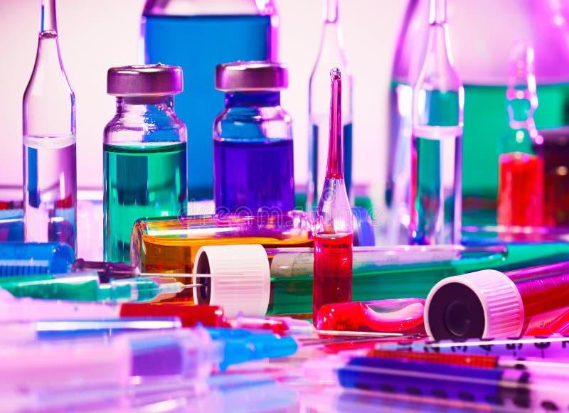 Medical laboratory glass equipment. Still life on blue purple stock images