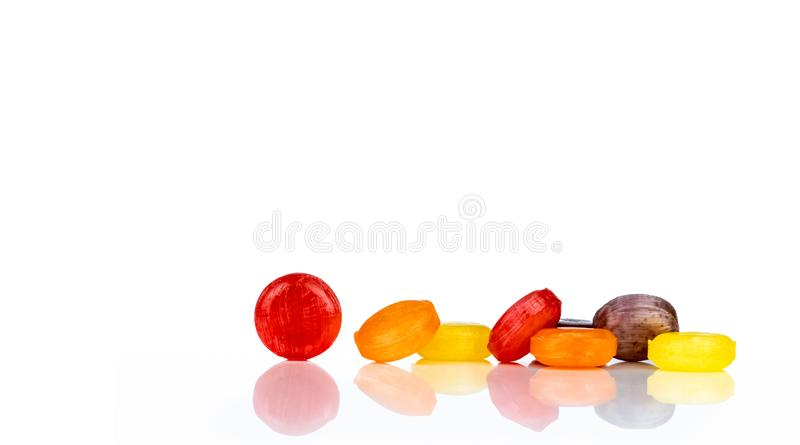 Medical lozenges for relief cough, sore throat and throat irritation isolated on white background. Cough and colds drop. Colorful. Cough pastille. Red, orange stock photography