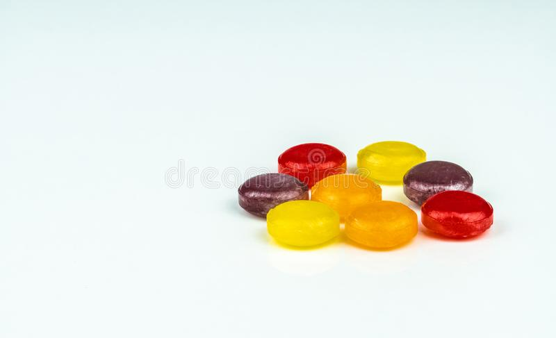 Medical lozenges for relief cough, sore throat and throat irritation isolated on white background. Cough and colds drop. Colorful cough pastille. Red, orange royalty free stock image