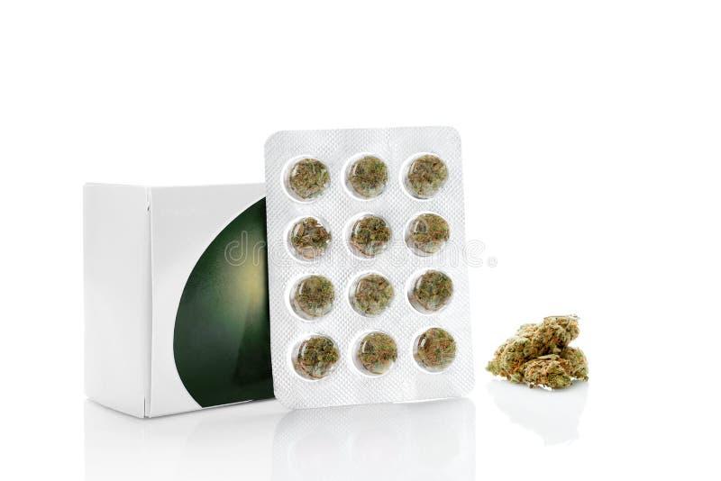 Medical Marijuana in blister pack. Medical Marijuana in aluminum blister pack with marijuana bud on white background. Natural remedy. Alternative medicine stock photo