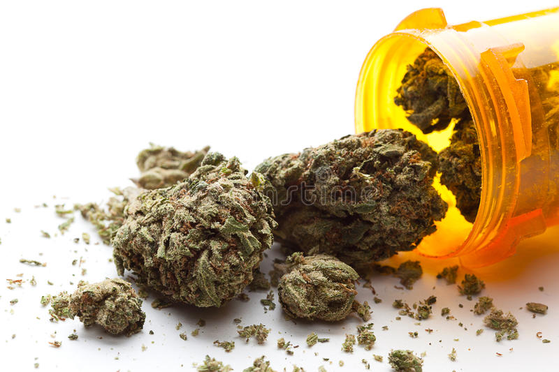 Medical Marijuana. Pouring out of a prescription bottle against white