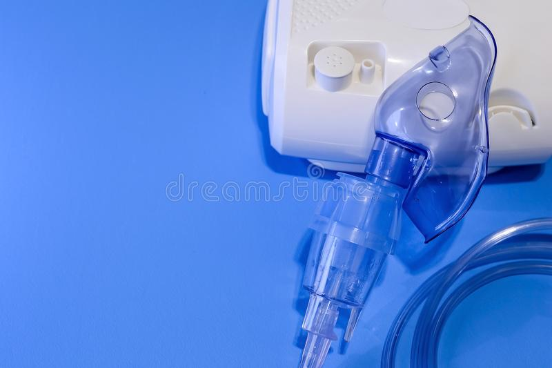 Medical nebulizer for the treatment of bronchitis. Camera agains. Medical nebulizer for the treatment of bronchitis royalty free stock photos