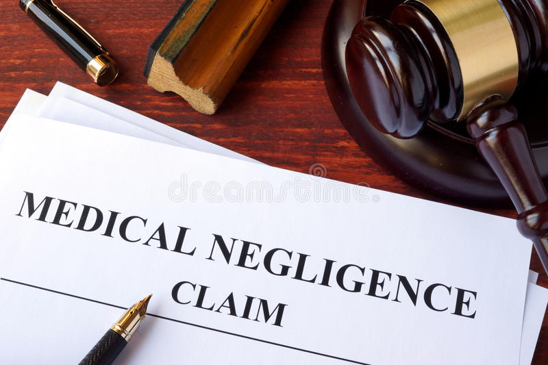 Medical Negligence claim. Medical Negligence claim and gavel on a table stock images