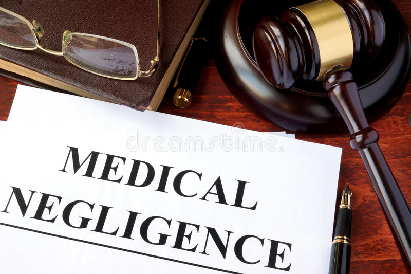 Medical Negligence form. Documents and gavel on a table stock photography