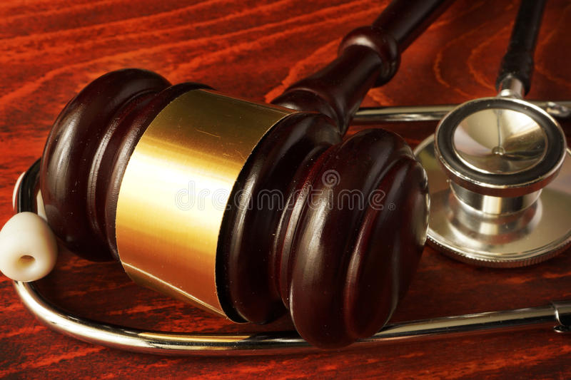 Medical negligence. Gavel and stethoscope. Malpractice concept stock photography
