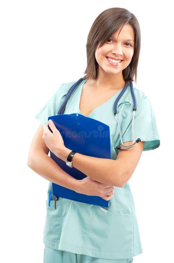 Medical nurse. Smiling medical nurse with stethoscope. Isolated over white background royalty free stock photo