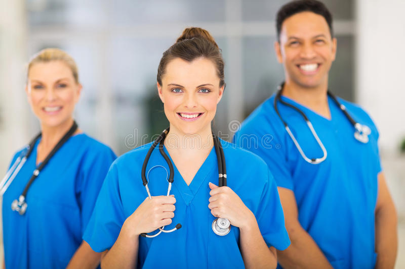 Medical nurse colleagues. Attractive medical nurse and colleagues in hospital royalty free stock photo