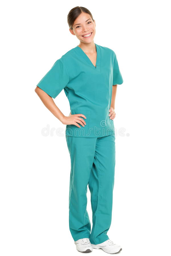 Medical nurse isolated in full body length. In green scrubs on pure white background. Multiracial Asian and Caucasian female medical professional doctor or stock photo