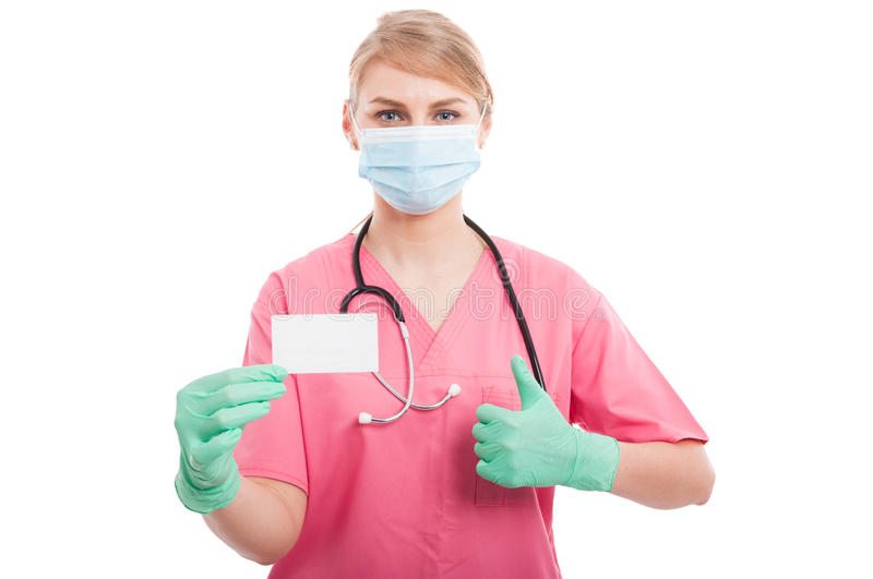 Medical nurse lady showing blank business card and like. Gesture isolated on white background royalty free stock image