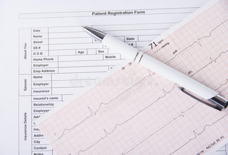 Medical Patient Registration Form With Cardiogram And Pen Stock