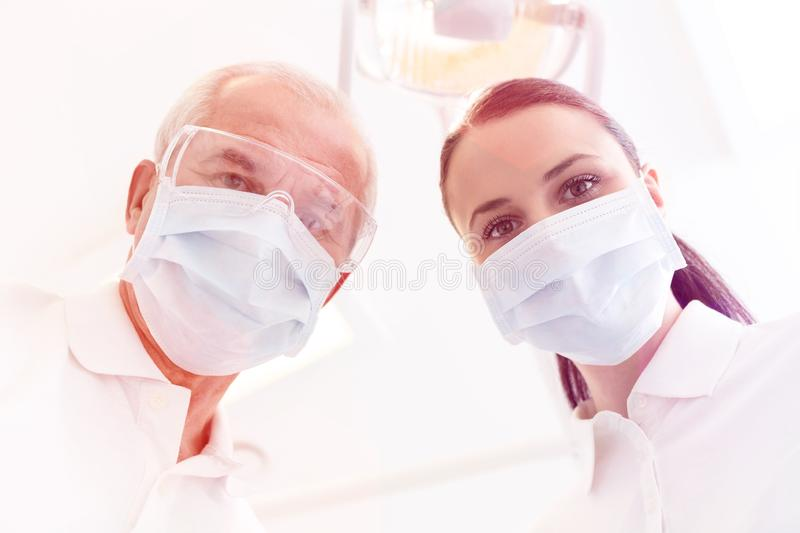 Medical personel doctors, nurses and dentists during different procedures with patients royalty free stock image