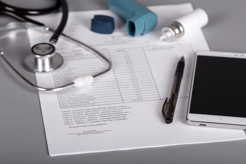 Medical phonendoscope, an inhaler and sheet of doctor appointments royalty free stock photography