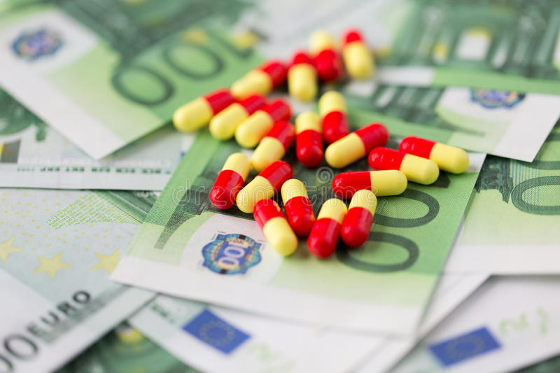 Medical pills or drugs and euro cash money stock image image of medicine finance health care and drug trafficking medical pills or drugs and euro cash money on table malvernweather Image collections