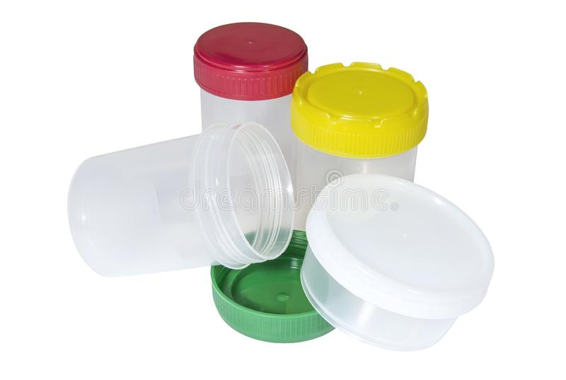 Medical plastic containers with multicolored caps for collecting biological material. On the white background royalty free stock photo