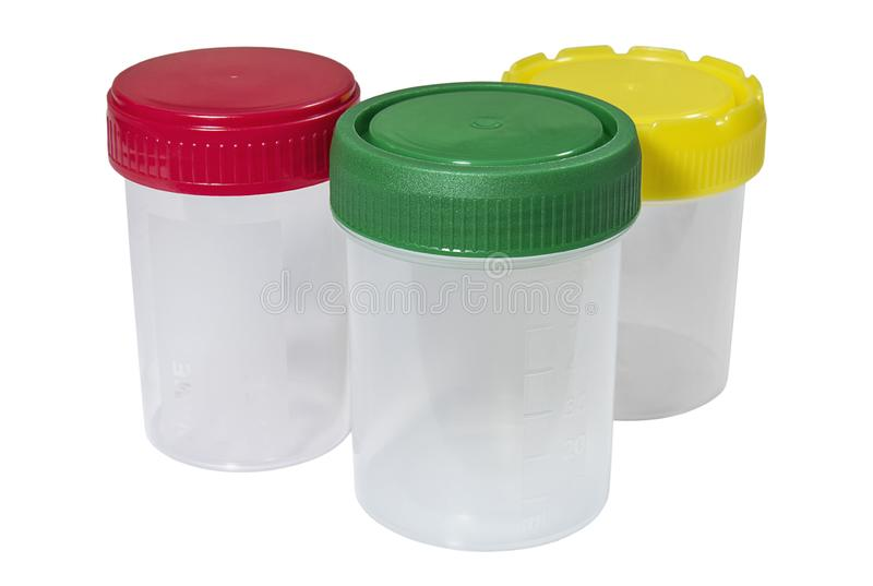 Plastic containers for the collection of biological material with multicolored caps. Medical plastic containers with multicolored caps on white background royalty free stock photos