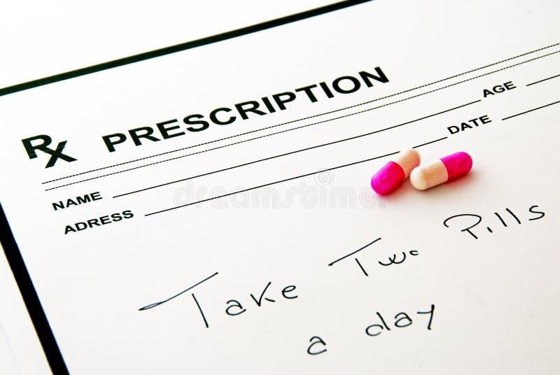 Medical prescription pad and pills stock images