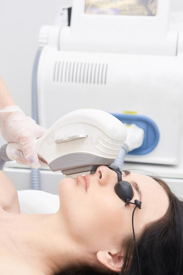 Medical procedure. Hair removal on the face. Laser hair removal. Bright skin royalty free stock photography