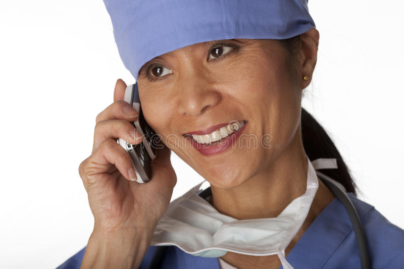 Download Medical Professional In Scrubs On The Phone. Isola Stock Photo - Image: 13192512