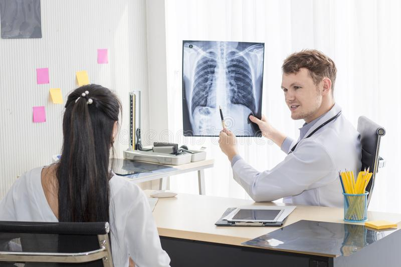 Medical professionals Caucasian man holding x-ray royalty free stock image