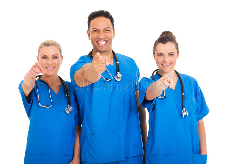 Medical professionals pointing. Portrait of happy medical professionals pointing at the camera stock photography