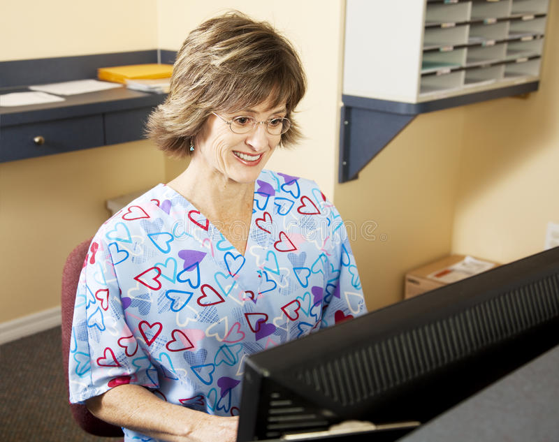 Medical Receptionist Working Stock Image