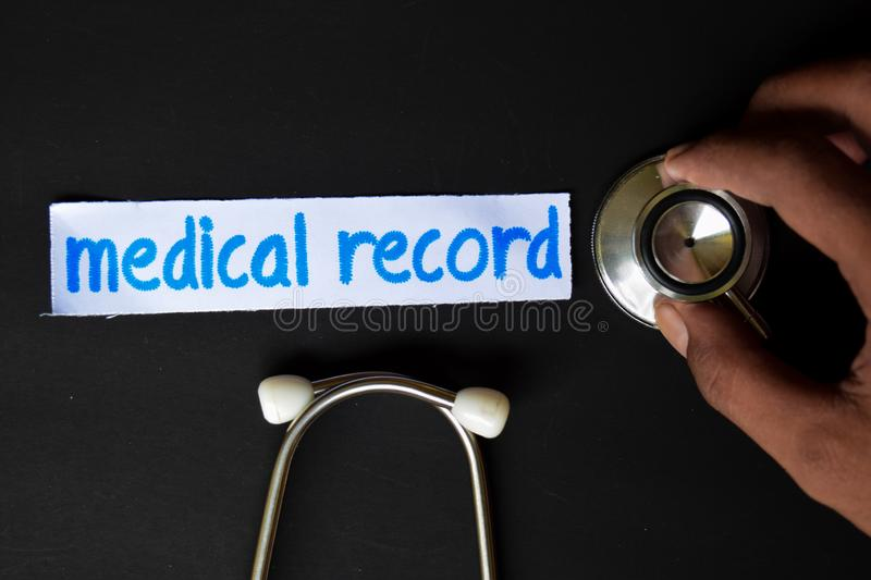 Medical record inscription with the view of stethoscope stock image