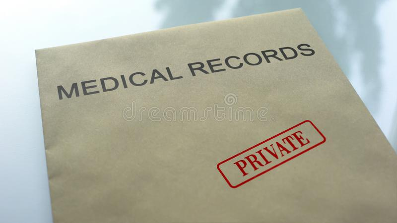 Medical records private, seal stamped on folder with important documents, health. Stock photo royalty free stock photo