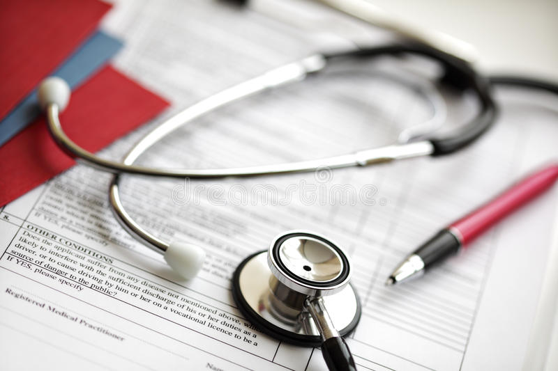 Medical records and stethoscope stock image