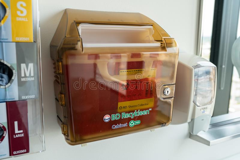 Medical recycling box for disposal of used needles. stock photo